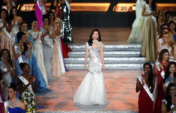 Lu Yuan, Miss China, reacts after entering the semi final at the Miss World Grand Final in Sanya, in southern China's Hainan