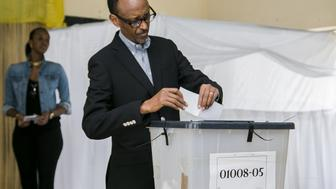 Rwandan President Paul Kagame casts his ballot in Kigali on December 18,2015 in a referendum to amend the constitution allowing him to rule until 2034.  Long lines of Rwandans queued to vote in a referendum to amend the constitution allowing President Paul Kagame to rule until 2034, with few expecting the changes to be rejected.  The proposed amendments have been denounced by Washington and Brussels as undermining democracy in the central African country.  / AFP / CYRIL NDEGEYA        (Photo credit should read CYRIL NDEGEYA/AFP/Getty Images)