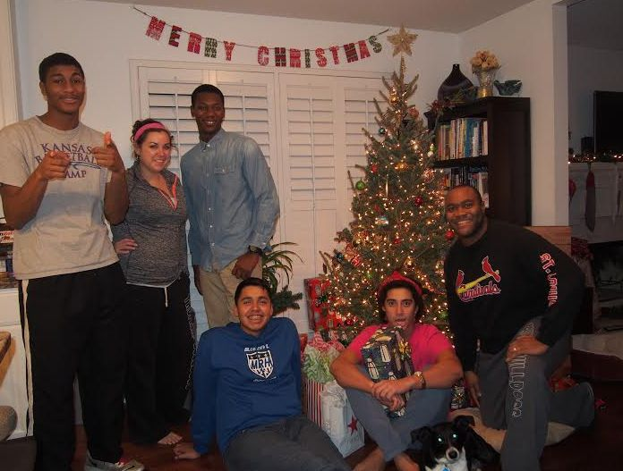 Students and house parents celebrating Christmas at Joe's Place during the 2014 - 2015 school year.
