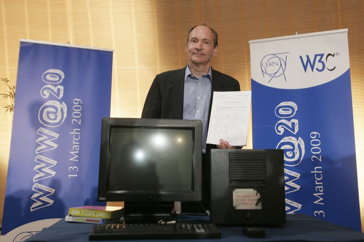Tim Berners-Lee, inventor of the Web, poses in front of the first World Wide Web server on March 13, 2009.