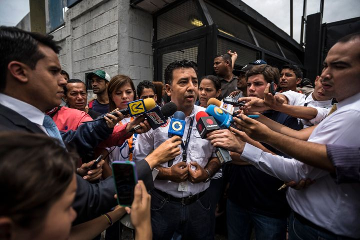 Douglas Vielma, of Empresas Polar SA, center, speaks to members of the media outside a warehouse in Caracas, Venezuela in&nbs
