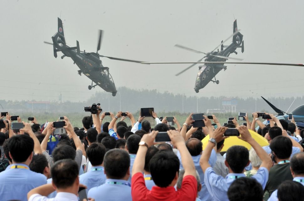 People take photos of the Harbin Z-19 at the International Helicopter Exposition in Tianjin, China, on Sept. 9.