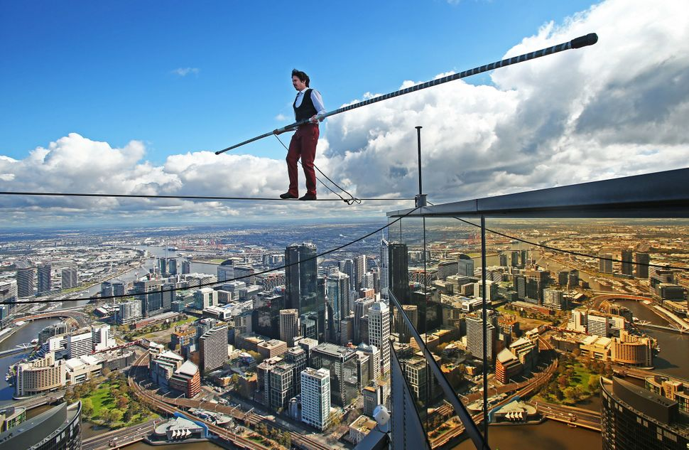 "High-wire artist Kane Petersen&nbsp;<a href=""https://www.youtube.com/watch?v=dHvr8rx2_S8"">walks a tightrope</a>&nbsp;300 mete"