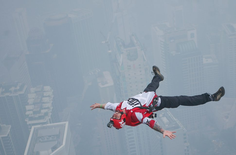 A base jumper leaps from a 300-meter-high (984-feet-high) building during the International Tower Jump in Kuala Lumpur,