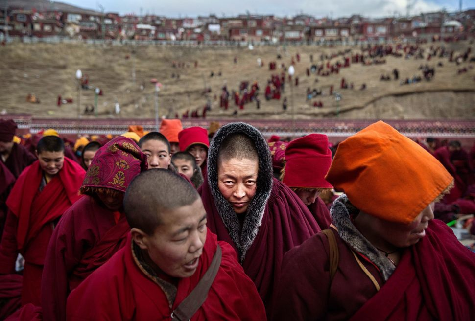 Tibetan Buddhist nuns stand after a chanting session in Sertar county, in the Garze Tibetan Autonomous Prefect