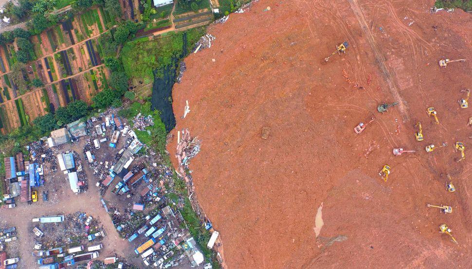 Cranes dig through debris in search of missing people.