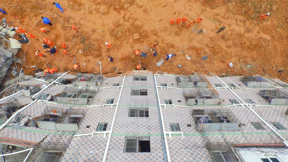 Chinese rescue teams work, as photographed from above.
