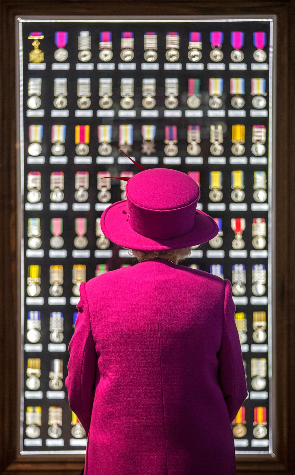 Queen Elizabeth II looks at a cabinet of medals during a Nov. 5 visit to the Ministry of Defense's Joint Casualty and Compass
