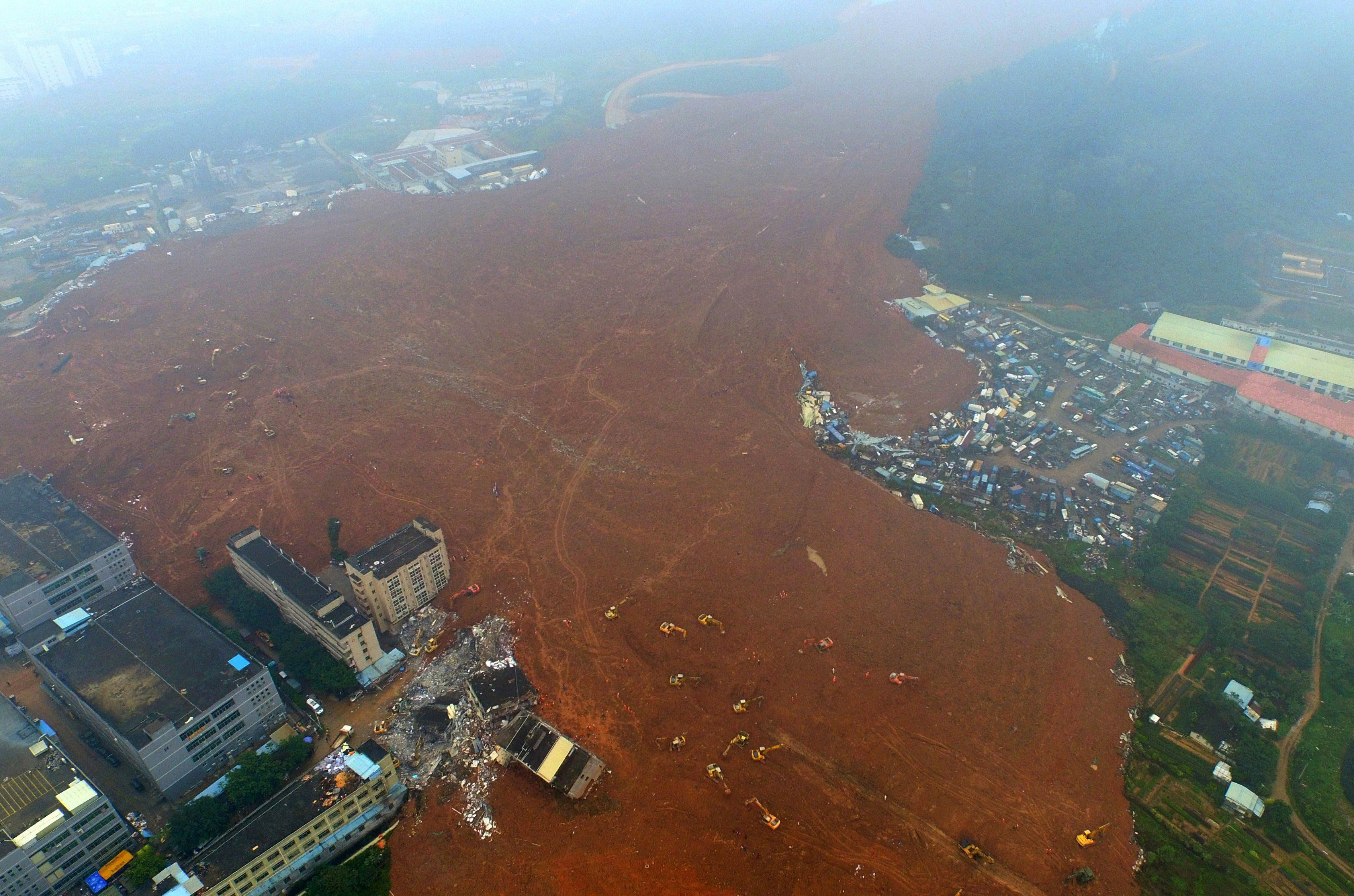 In this aerial photograph the site of a landslide that hit an industrial park is seen in Shenzhen in south China's Guangdong province on December 21, 2015. Some 85 people were missing on December 21 after a huge landslide caused by illegal soil dumping buried more than 30 factory and residential buildings in a sea of mud, China's second industrial disaster in four months. CHINA OUT   AFP PHOTO / STR / AFP / STR        (Photo credit should read STR/AFP/Getty Images)