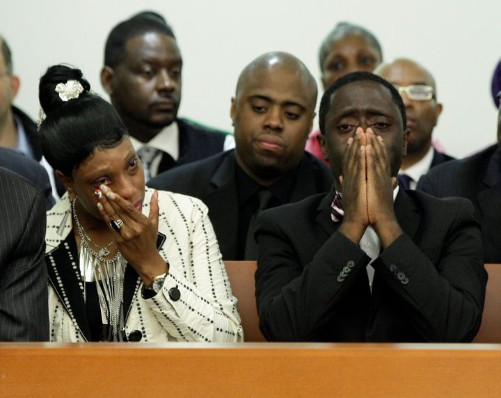 Constance Malcolm and Frank Graham, parents of Ramarley Graham, weep during the arraignment of Officer Richard Haste. As it b