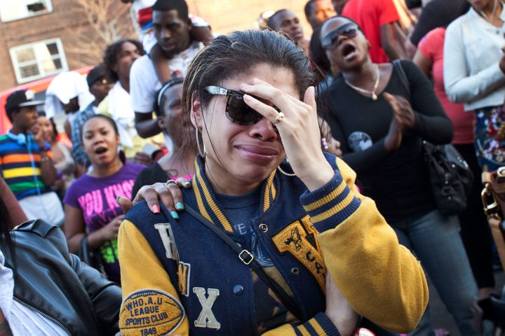 A woman cries during a vigil for Ramarley Graham outside the NYPD's 47th precinct on March 22, 2012.