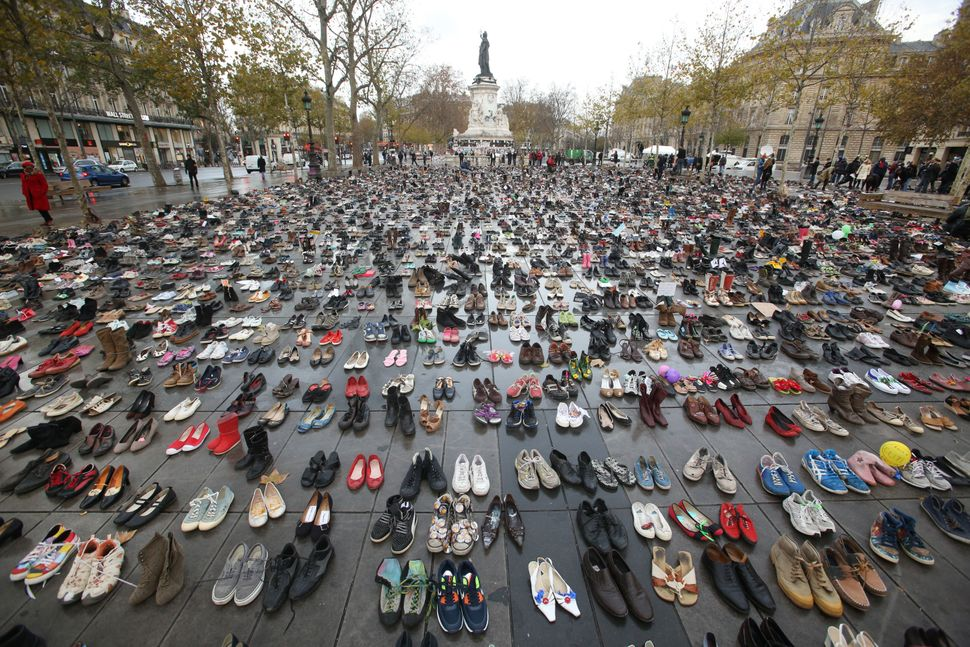 "The Place de la Republique in Paris is <a href=""https://www.huffpost.com/entry/empty-shoes-left-out-to-replace-cancelled-pari"