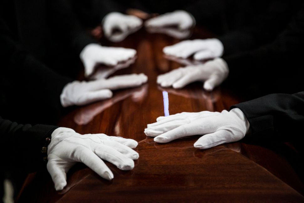 Pallbearers stand guard over a casket at a memorial service in Santa Ana, California, honoring Tin Nguyen, a victim of t