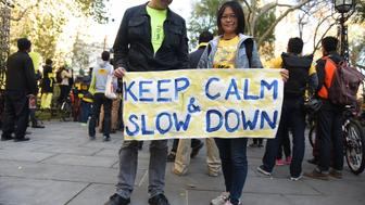 MANHATTAN, NEW YORK CITY, NEW YORK, UNITED STATES - 2015/11/15: Slow down banner at city hall park. Transportation Alternatives held its World Day of Remembrance for victims of traffic accidents with speeches by mayor de Blasio, other public officials and a march from city hall to the United Nations. (Photo by Andy Katz/Pacific Press/LightRocket via Getty Images)