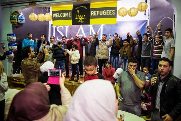 UNION CITY, NJ - DECEMBER 20:  Syrian refugees are welcomed to the United States at a party in their honor at the North Hudso