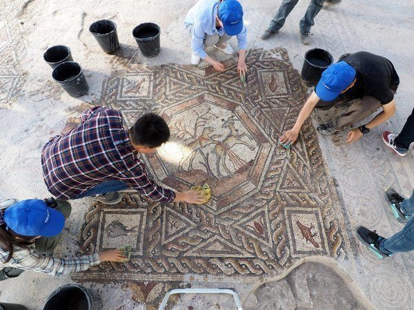 "The remains of an <a href=""https://www.huffpost.com/entry/roman-era-mosaic-unearthed-in-israel_564a1d84e4b045bf3df032bf"">extr"