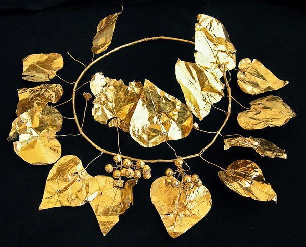 "Rare treasures, such as this gold wreath, were found in <a href=""https://www.huffpost.com/entry/cyprus-tomb-ancient-aristocra"