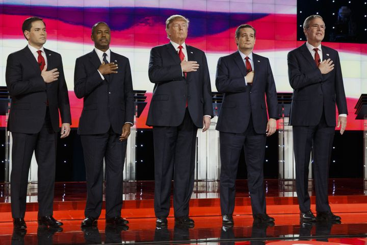 2016 Republican presidential candidatesstand on stage during the pledge of allegiance at the start of the Republican presiden