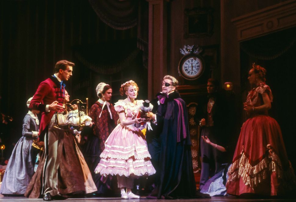 American dancer Mary Barton (as Clara) and New Zealander Alexander Grant (as Dr Drosselmeyer) perform during Act I of the Jof