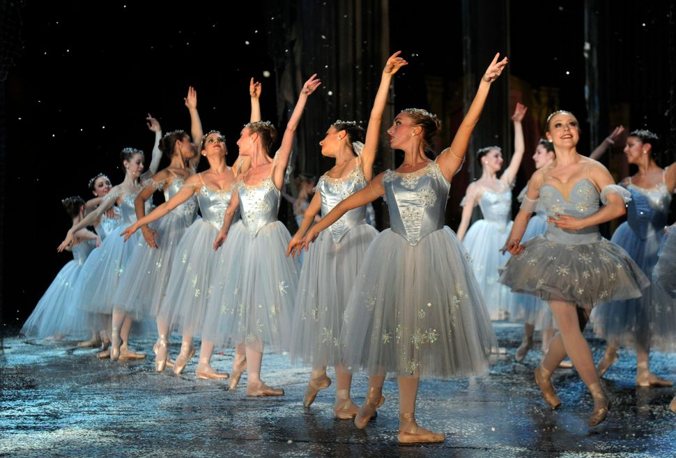 "Snowflakes and crystals dance in the snow scene during a production of ""The Nutcracker"" by the Colorado Ballet in 2010."