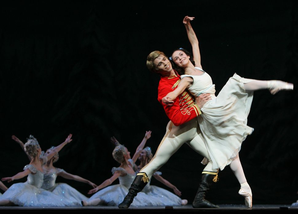 Clara, played by Iohna Loots, and Hans-Peter, portraied by Ricardo Cervera, and members of the Corps de Ballet of the Royal B