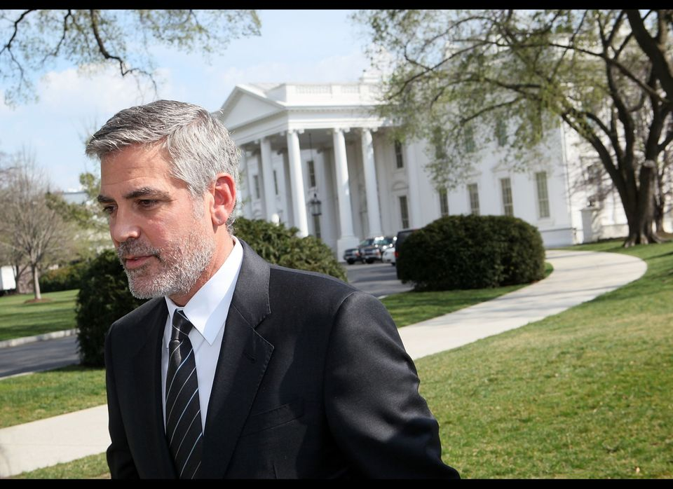 Actor George Clooney leaves after he spoke to the media March 15, 2012 at the White House in Washington, DC. Clooney had meet