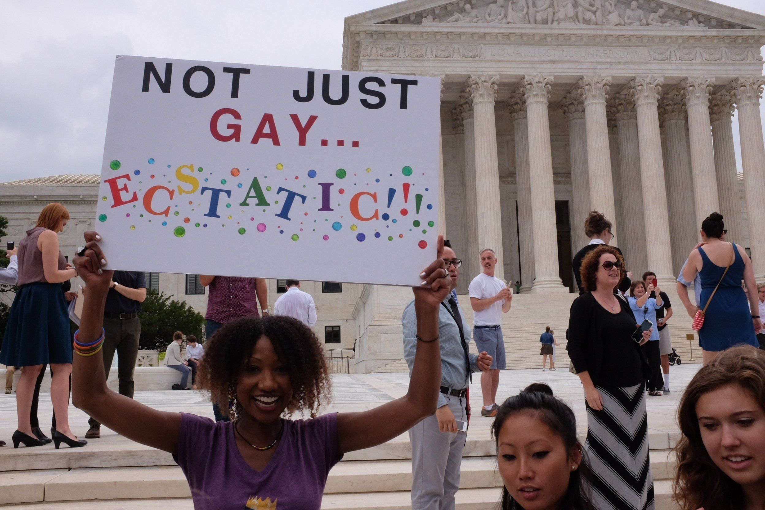 WASHINGTON, UNITED STATES - JUNE 26: Hundreds gather outside of the Supreme Court on Friday to celebrate the decision to legalize gay marriage in all 50 states, in Washington, on June 26, 2015. (Photo by Michael Hernandez/Anadolu Agency/Getty Images)