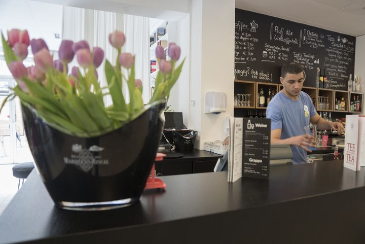 Tayeb from Algeria prepares drinks in the lobby bar of hotel Magdas in Vienna, Austria on April 16, 2015.
