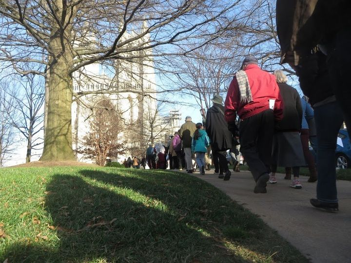 Clergy and community members walk toward the Washington National Cathedral, the second stop on Sunday's interfaith pilg