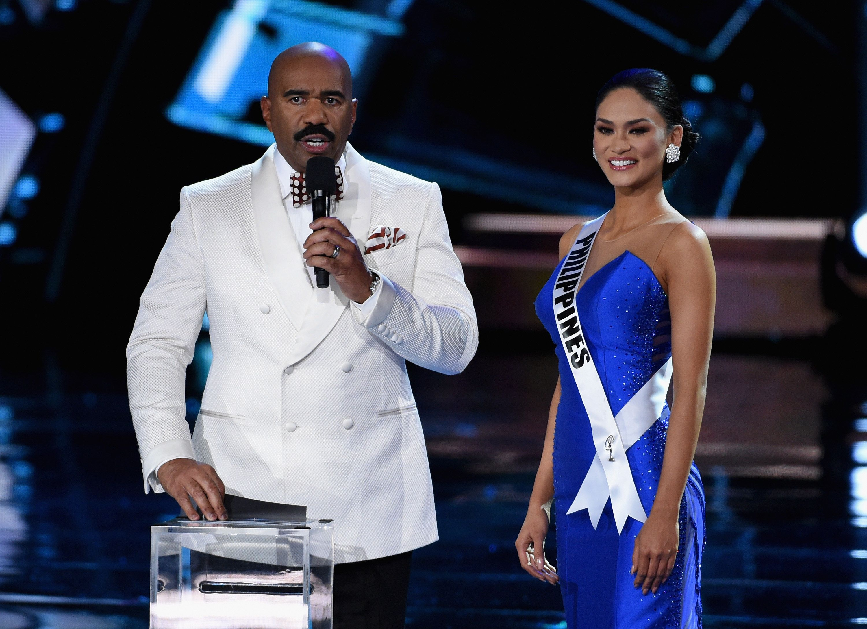 LAS VEGAS, NV - DECEMBER 20:  Host Steve Harvey (L) asks Miss Philippines 2015, Pia Alonzo Wurtzbach, a question during the interview portion of the 2015 Miss Universe Pageant at The Axis at Planet Hollywood Resort & Casino on December 20, 2015 in Las Vegas, Nevada.  (Photo by Ethan Miller/Getty Images)