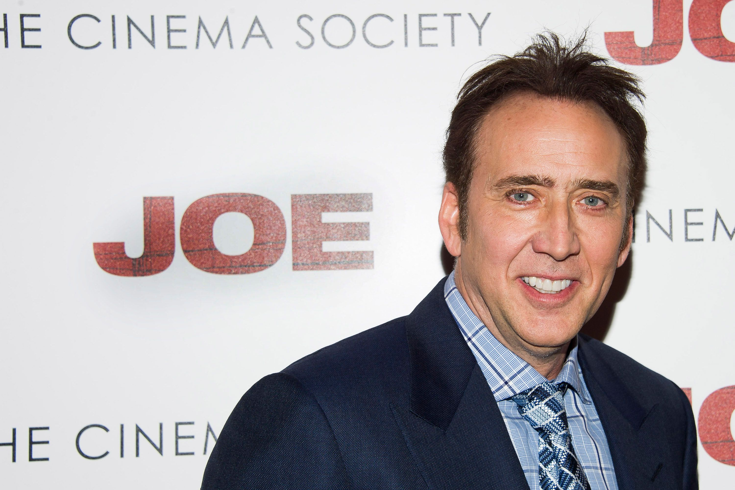 """Nicolas Cage arrives for the """"Joe"""" premiere hosted by Lionsgate and The Cinema Society on Wednesday, April 9, 2014, in New York. (Photo by Charles Sykes/Invision/AP)"""