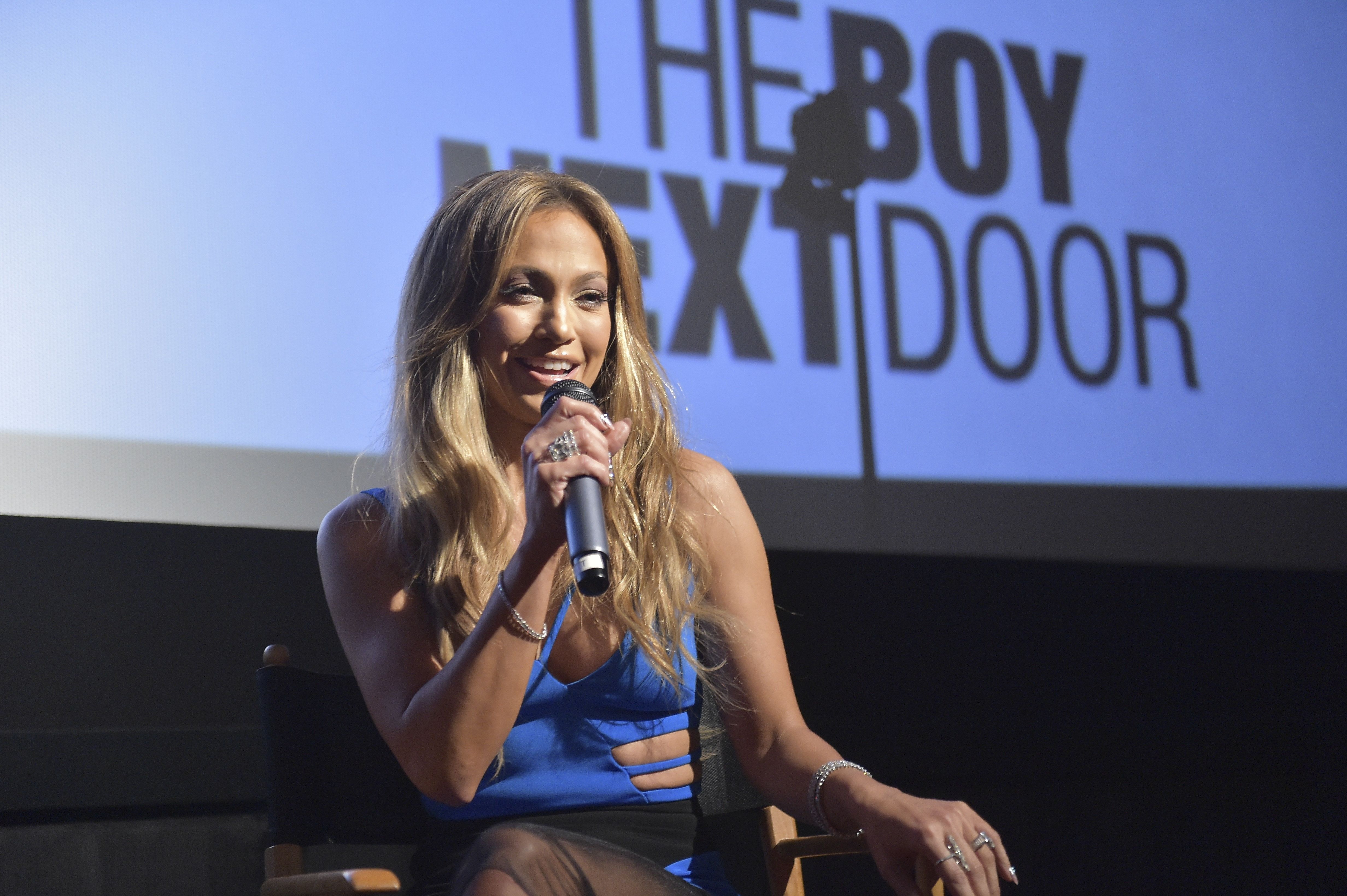 MIAMI, FL - JANUARY 13:  Jennifer Lopez speaks during a Q & A session following the 'The Boy Next Door' Miami VIP Screening at Dolphin Mall on January 13, 2015 in Miami, Florida.  (Photo by Gustavo Caballero/Getty Images for Universal Pictures)