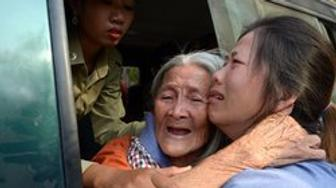 Cambodian land rights activist Nget Khun hugs her daughter through a window of a prison car before a court hearing in Phenom Penh on Jan. 26, 2015. Khun was arrested for protesting against evictions connected to a World Bank-financed land management program.
