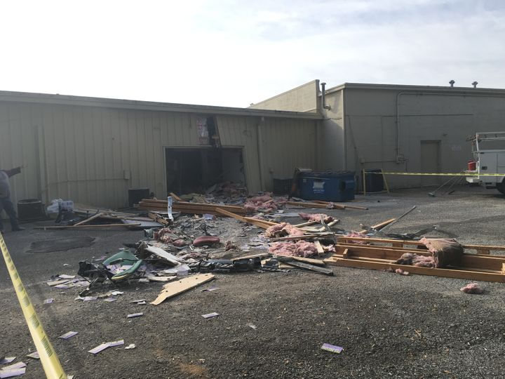 Debris from behind the Advance Tax Services business, where the collision occured, is seen.