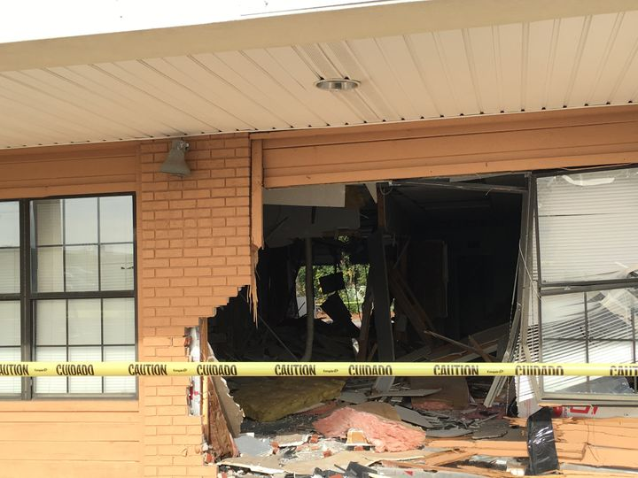 The 40-year-old, who was taken for a mental evaluation, managed to break through the business' back wall.