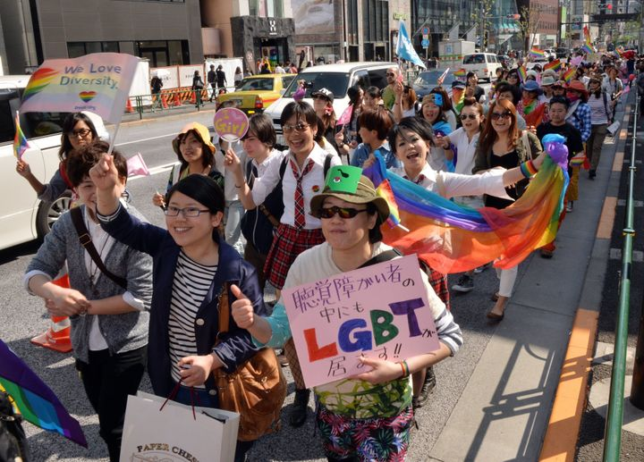Supporters of the lesbian, gay, bisexual and transgender community march to  take part in