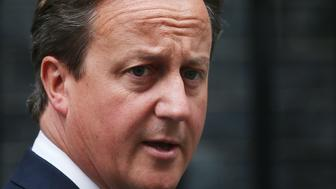 LONDON, ENGLAND - SEPTEMBER 01:  Prime Minister David Cameron leaves Downing Street on September 1, 2014 in London, England. Mr Cameron is expected to announce new counter-terrorism measures in Parliament.  (Photo by Peter Macdiarmid/Getty Images)
