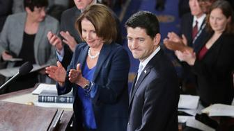 WASHINGTON, DC - OCTOBER 29:  Speaker-elect of the House Paul Ryan (R-WI) (C) and Minority Leader Nancy Pelosi (D-CA) (L) applaud on the floor of the House chamber at the U.S. Capitol October 29, 2015 in Washington, DC. Ryan was elected the 62nd speaker of the House with 236 votes and will attempt to steer that chaotic legislative body following the resignation of former Speaker John Boehner (R-OH).  (Photo by Chip Somodevilla/Getty Images)