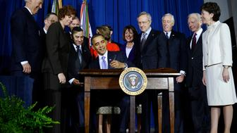 US President Barack Obama signs the Don't Ask, Don't Tell Repeal Act of 2010 into law at the Department of the Interior in Washington, DC, on December 22, 2010. Obama signed a law allowing gays to serve openly in the military, repealing the 'Don't Ask, Don't Tell' policy in a sweeping and historic shift for the US armed forces. AFP PHOTO/Jewel Samad (Photo credit should read JEWEL SAMAD/AFP/Getty Images)