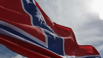 LOXAHATCHEE, FL - JULY 11:  A Confederate flag flies from a vehicle during a rally to show support for the American and Confederate flags on July 11, 2015 in Loxahatchee, Florida. Organizers of the rally said that after the Confederate flag was removed from South Carolinas State House it reinforced their need to show support for the Confederate flag which some feel is under attack.  (Photo by Joe Raedle/Getty Images)