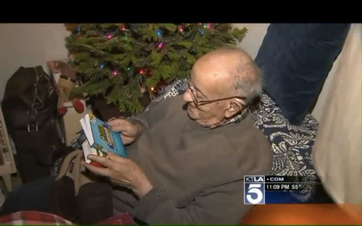 The 94-year-old WWII veteran is seen looking over crossword puzzles he was given as early Christmas presents.