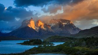 Torres Del Paine, Chilean PatagoniaThe famous  Torres Del Paine centerpiece � Cuernos del Paine. This was  the early morning sun hits the face of the mountain, and the dark stormy clouds glows and popes up!#chile #cuernos #lake #patagonia #pehoe #salto grande #south america #travel #Cuernos  #TorresDelPaines #adventure #chile #clouds #light #national park #nature #canon #canonmk5d3 #outdoor #outdoors  #patagonia500 #storm