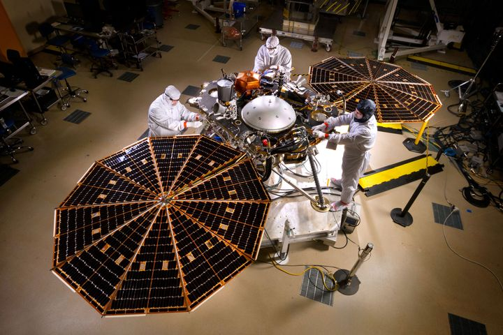 The solar arrays on NASA's InSight lander are deployed during a test conducted in a clean room at Lockheed Martin S