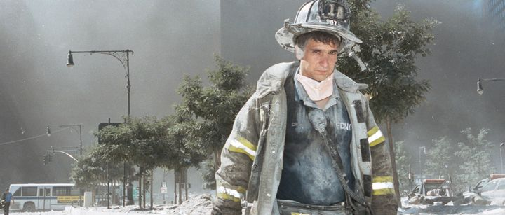 An unidentified New York City firefighter walks away from Ground Zero after the collapse of the World Trade Center on Se