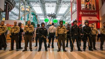 BLOOMINGTON, MN -  DECEMBER 23:  Police line up to move Black Lives Matter protestors out of the rotunda area of the Mall of America on December 23, 2015 in Bloomington, Minnesota. Black Lives Matter Minneapolis staged a brief protest at the Mall of America in Bloomington, MN before moving their protest to the airport. (Photo by Stephen Maturen/Getty Images)