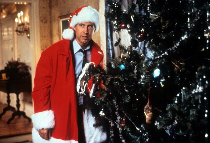 chevy chase hides behind the tree in a scene from the film christmas vacation - Christmas Vacation Lawn Decorations