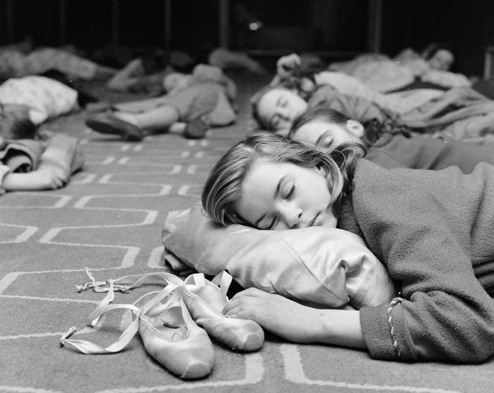 "Twelve-year-old ""Nutcracker"" performer Suzanne Cullingford keeps one hand on her ballet slippers during a nap at the Royal Fe"