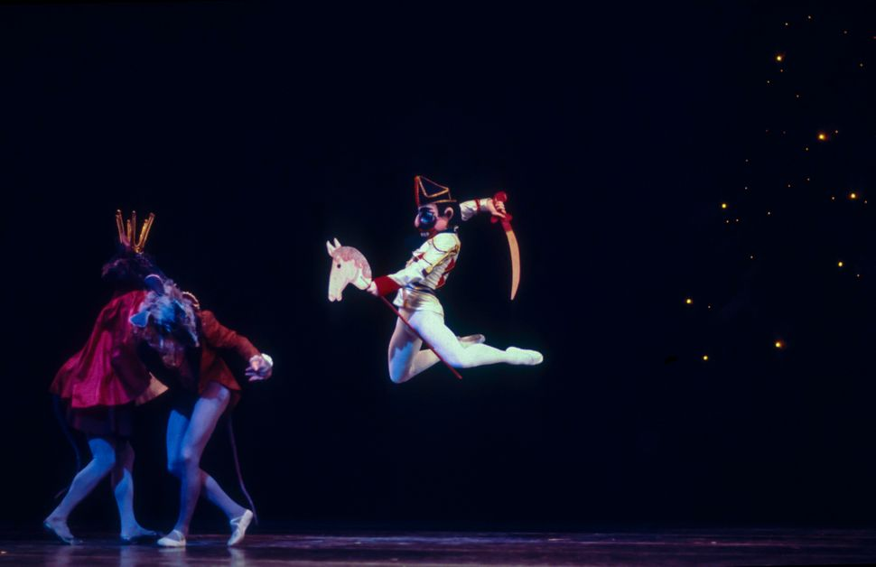 Russian-born American dancer Mikhail Baryshnikov (as the Nutcracker Prince) fights the Mouse King during a performance of the