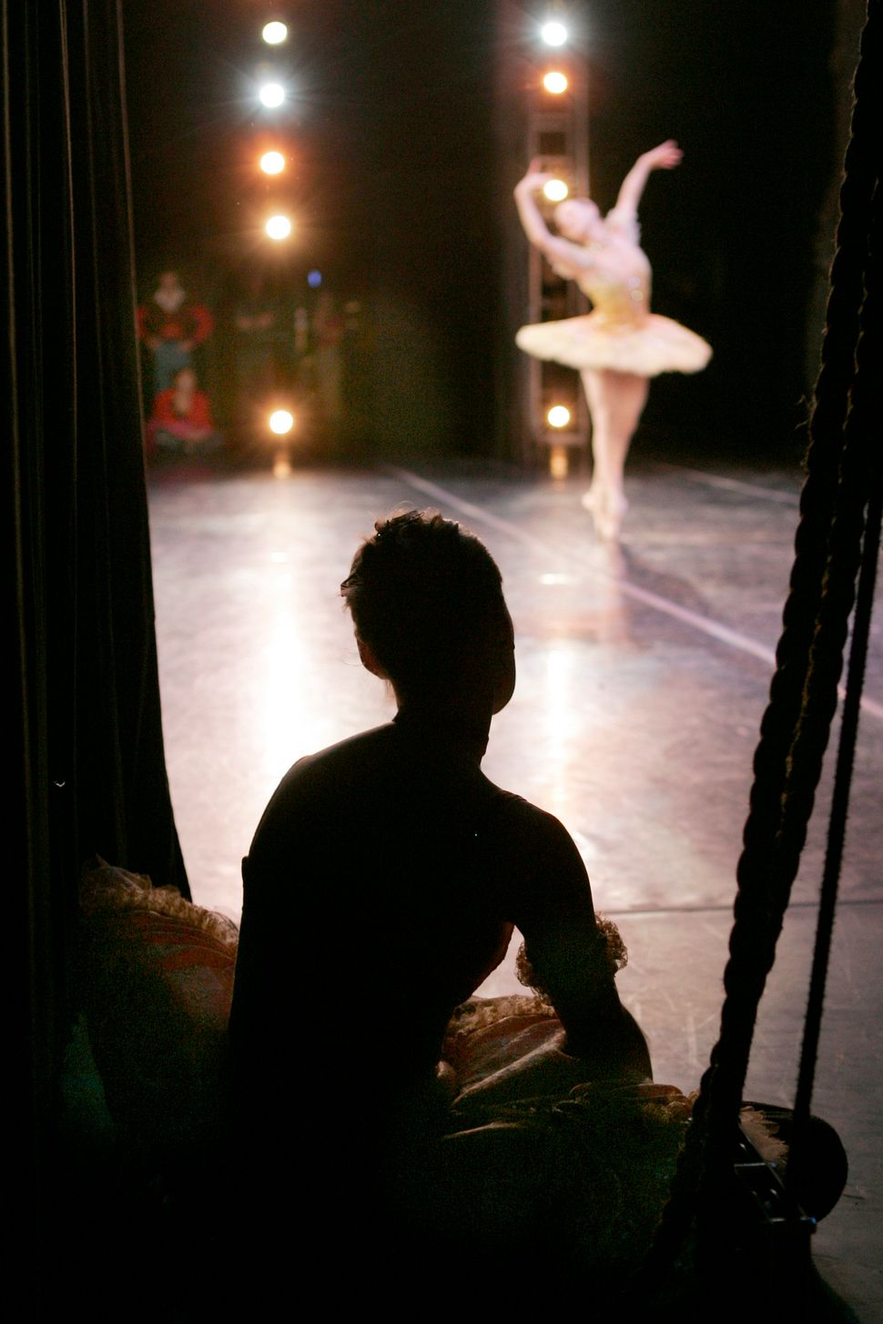 "Boston Ballet soloist Heather Myers, top, dances in the role of ""Dew Drop"" during a rehearsal of the second act of the compan"