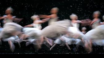 Members of the Corps de Ballet of the Royal Ballet dance as snowflakes in the Land of the Snow scene, during a final dress rehearsal of the Nutcracker Ballet at the Royal Opera House in London, Monday Dec. 5, 2005. (AP Photo/Alastair Grant)